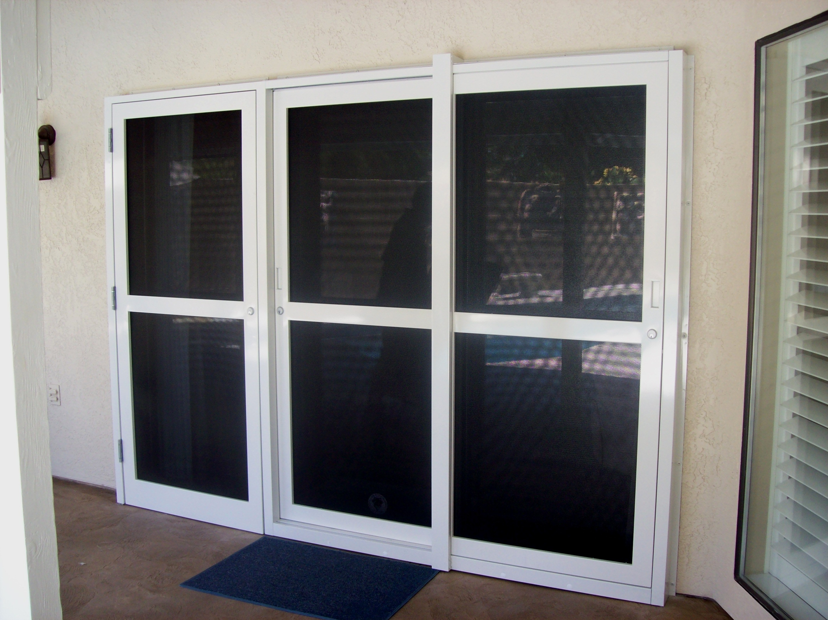 Patio door 3 panel sliding glass patio doors for Full glass patio door