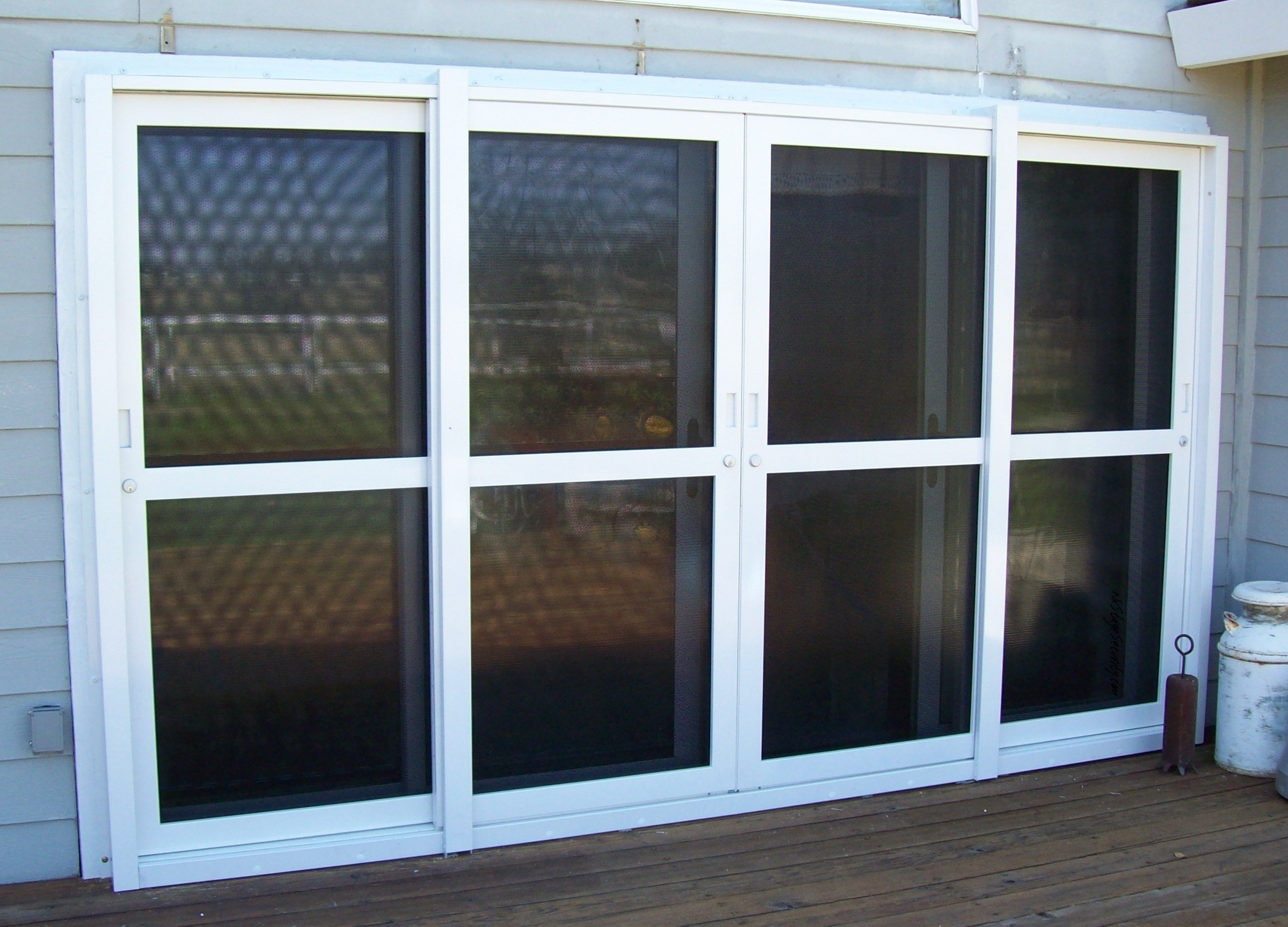 Security doors security door sliding patio door for Backyard sliding door